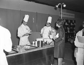 Hotel Motel Restaurant Administration Program; a student preparing a dessert while two people watch