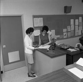 BC Vocational School Commercial Program; instructor and student looking at paperwork [2 of 2]