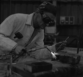 Welding, 1968; man wearing protective goggles welding [4 of 6]