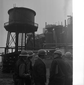 Forestry, Wood fiber BCIT tour, November 26, 1965; a group of men standing outside a wood fiber f...