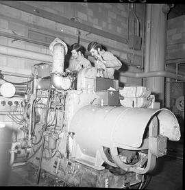 BC Vocational School Diesel Mechanic program ; two students repairing a large diesel engine [1 of 3]