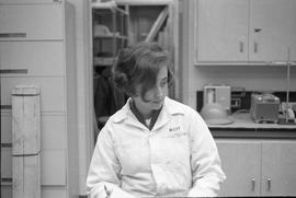 Forest Products; a woman wearing  a lab coat standing in a classroom