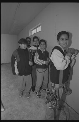 Coast Salish youths using power tools during gym construction [8 of 8 photographs]