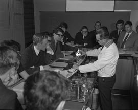 Hotel Motel Restaurant Administration Program;  bartending instructor pouring a drink and student...