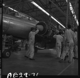 British Columbia Vocational School image of an Aeronautics instructor and students working on an ...