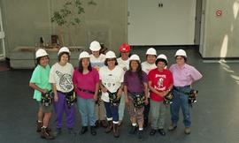 Pre-trade Aboriginal women; students wearing hard hats and tool belts [6 of 8 photographs]