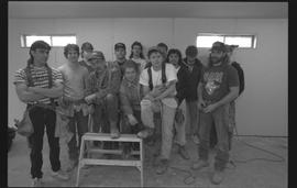 Students holding power tools and posing for a group shot during gym construction [3 of 8 photogra...