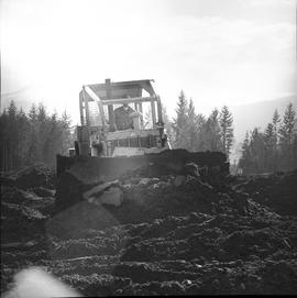 Heavy duty equipment operator, Nanaimo ; man operating a bulldozer moving dirt [5 of 9]