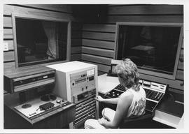 Broadcast Communication; man working in the television audio control room two