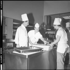 BC Vocational School Cook Training Course ; a student chopping celery ; a student reaching into c...