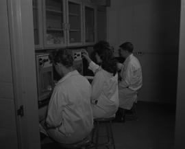 Food Processing Technology, 1966; three people in lab coats sitting at a counter studying samples...