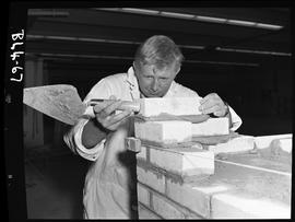 B.C. Vocational School image of a Bricklaying student laying bricks