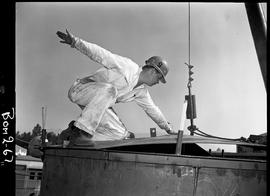 B.C. Vocational School; Boiler making program student on top of a large tank outside at Burnaby c...