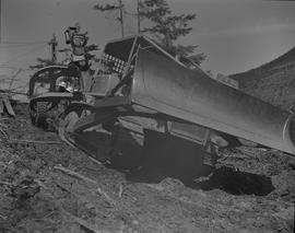 Logging, 1967; a CAT dozer ; men working in the background
