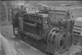 Pacific Vocational Institution ; two men working on large machinery [3 of 4]