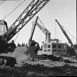 Heavy duty equipment operator, Nanaimo ; an Insley excavator scooping dirt ; two pieces of heavy ...