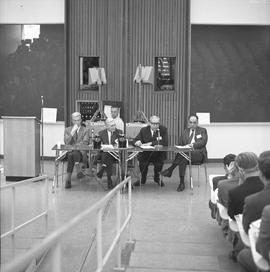 CVA Convention, 1969 ; four men sitting at a table with microphones and audience
