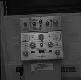 Medical radiography; control panel for a General Electric x-ray generator with warning sign for p...