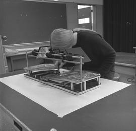 BCIT Programs Forestry Technology ; woman adjusting settings on a radial planimetric plotter