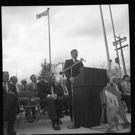 Merger of BCIT and PVI celebrations April 1986; man talking at outdoor podium [2 of 4 photographs]