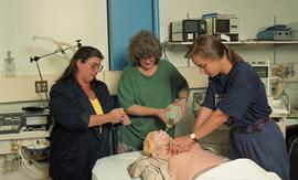 C/Care (students in action), 1993, students with medical dummy [4 of 7 photographs]