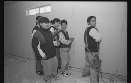 Coast Salish youths using power tools during gym construction [5 of 8 photographs]