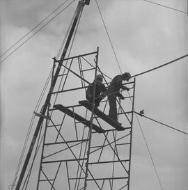Structural steel, 1971; two students assembling scaffolding