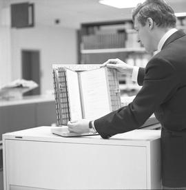 BCIT Library ; man looking at a periodical index