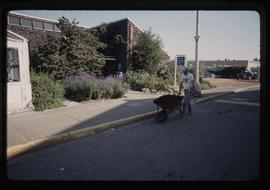 Horticulture 1990, man with wheelbarrow outside building 2