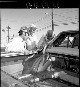BC Vocational School image of Autobody program students working on a vehicle outside [1 of 2 phot...
