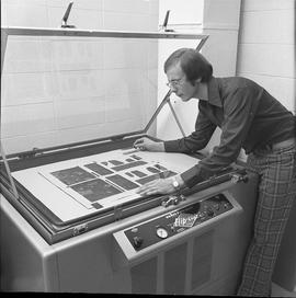BCVS Graphic arts ; man positioning a poster in a Nuarc plate maker [3 of