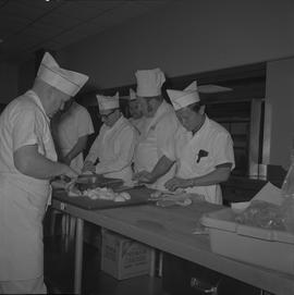 Tow boat cook course; instructor watching students chopping vegetables [1 of 6]