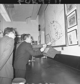 BCIT Programs Forestry Technology ; two men pointing at a map