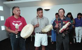 Three First Nations  men playing instruments at the First Nations graduation [1 of 3 photographs]