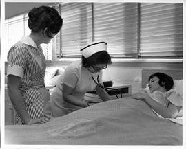 BCVS Nursing student, and nurse with stethoscope and patient (ca. 1968)