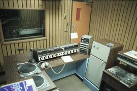 Broadcast Communications; radio control booth and equipment