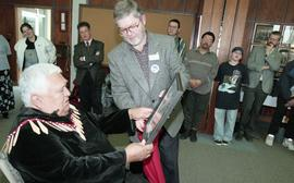 BCIT open house '98, staff member presenting a framed photo to a First Nations elder [2 of 5 phot...