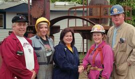 Steel trades; Anne St. Eloi shaking hands with a woman in a hard hat and safety gear beside anoth...