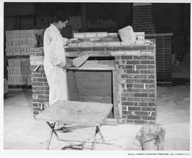 Bricklaying; A student building a brick fireplace hearth; Photo by the Division of Vocational Cur...