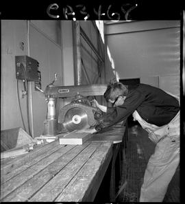 B.C. Vocational School; Carpentry Trades student cutting a piece of wood using a table saw inside...