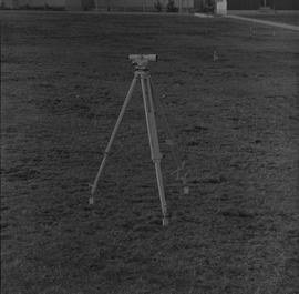 Survey, 1971; a level on a tripod on flat ground [2 of 2]