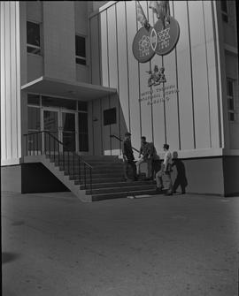 Nanaimo campus, 1967; three men standing in front of a building entrance