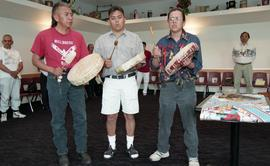 Three First Nations men playing instruments at the First Nations graduation [3 of 3 photographs]