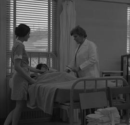 Practical nursing, Nanaimo, 1968; instructor and student checking a patient's temperature