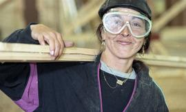 BCIT Women in Trades Training; carpentry, woman with eye protection, carrying wood [3 of 3 photog...