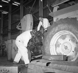BCVS Heavy duty mechanic program ; a student working on a tractor engine ; instructor watching [2...