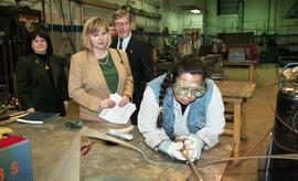 BCIT women in trades; steel fabrication, BCIT staff members and VIPs watching students work insid...