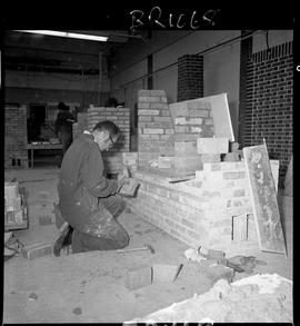 B.C. Vocational School image of a Bricklaying student shaping a brick