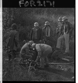 School Programs; 1960's; Forestry Technology - 1971, men in hardhats with pump, hose