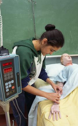 General Nursing, student with dummy patient in bed [3 of 8 photographs]